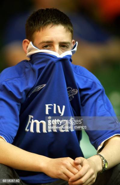 A dejected Chelsea fan sits in the stand after his team lost the FA Cup Final to Arsenal