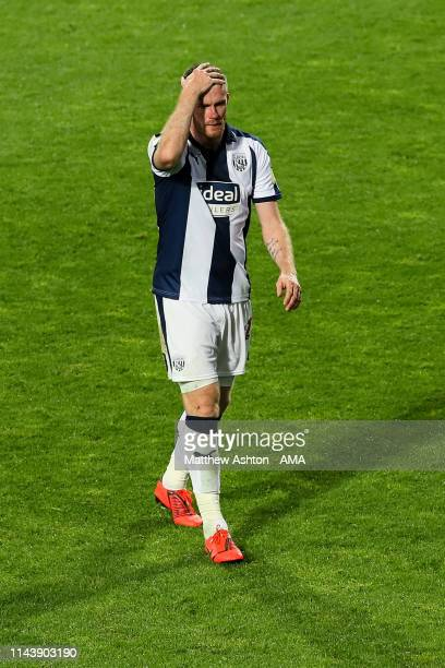 A dejected Chris Brunt of West Bromwich Albion walks off the pitch after receiving a red card during the Sky Bet Championship Playoff Semi Final...