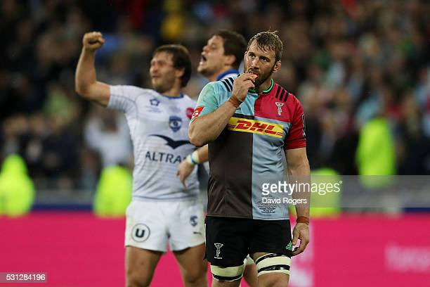 Dejected Chris Robshaw of Harlequins looks on as Montpellier players celebrate their 26-19 victory during the European Rugby Challenge Cup Final...