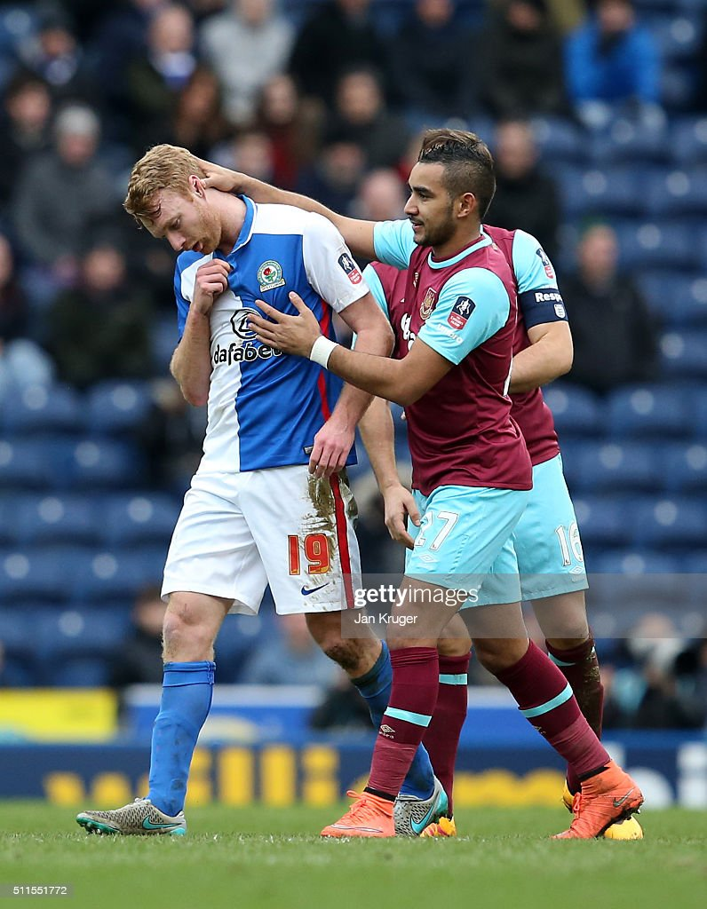 A dejected Chris Taylor of Blackburn Rovers is consoled by Dimitri Payet of West Ham United as he walks off the pitch after being sent off for a second bookable offence during The Emirates FA Cup fifth round match between Blackburn Rovers and West Ham United at Ewood park on February 21, 2016 in Blackburn, England.