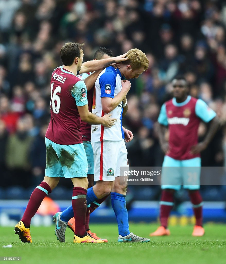 A dejected Chris Taylor of Blackburn Rovers is consoled by Mark Noble of West Ham United as he walks off the pitch after being sent off for a second bookable offence during The Emirates FA Cup fifth round match between Blackburn Rovers and West Ham United at Ewood park on February 21, 2016 in Blackburn, England.