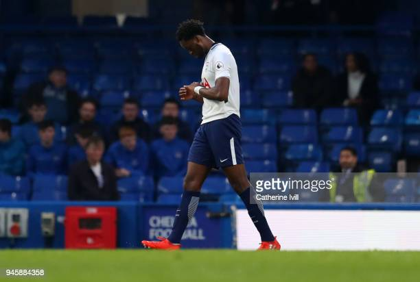 A dejected Christian Maghoma of Tottenham Hotspur leaves the pitch having been sent off during the Premier League 2 match between Chelsea and...