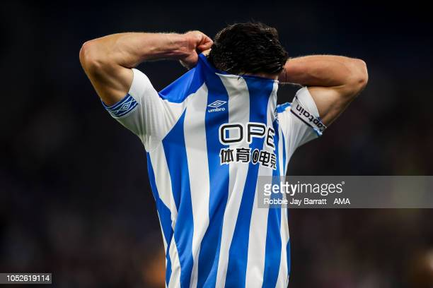 A dejected Christopher Schindler of Huddersfield Town reacts at full time during the Premier League match between Huddersfield Town and Liverpool FC...