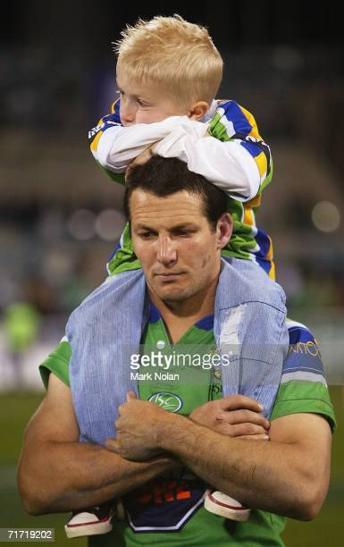 A dejected Clinton Schofcofske with his son Coby after the round 25 NRL match between the Canberra Raiders and the Melbourne Storm at Canberra...