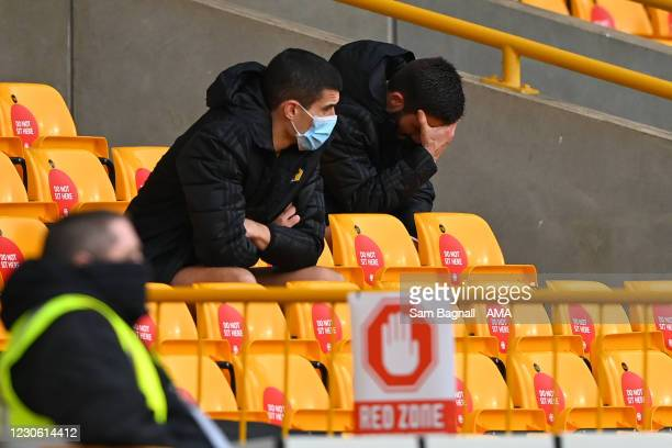 Dejected Conor Coady of Wolverhampton Wanderers and Joao Moutinho of Wolverhampton Wanderers during the Premier League match between Wolverhampton...