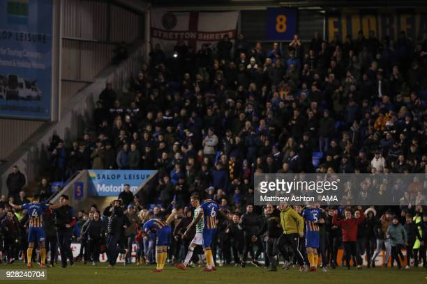 A dejected Corey Whelan of Yeovil Town as Shrewsbury Town fans invade the pitch at full time during the Checkatrade Trophy Semi Final between...