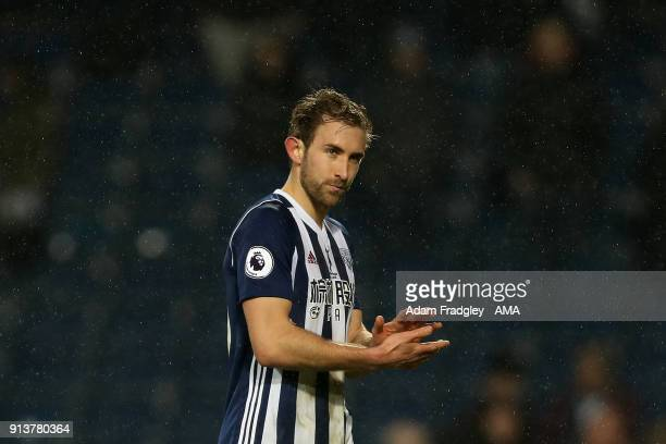 A dejected Craig Dawson of West Bromwich Albion applauds the West Bromwich Albion Fans at the final whistle during the Premier League match between...