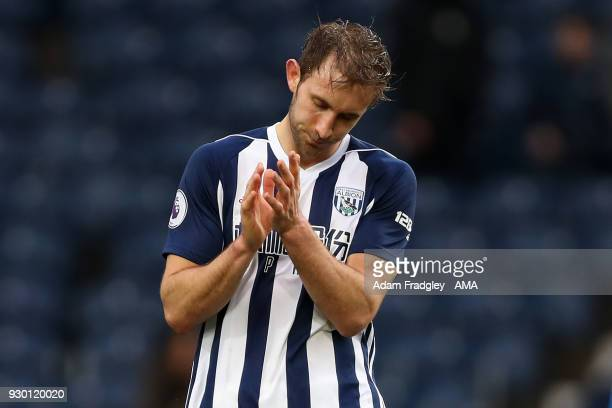 A dejected Craig Dawson of West Bromwich Albion reacts at the final whistle having lost 14 during the Premier League match between West Bromwich...