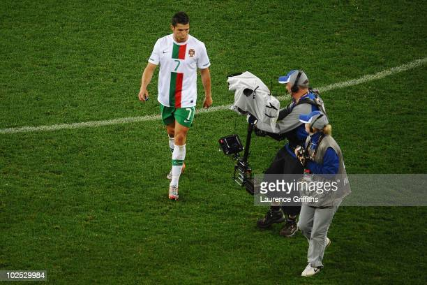 Dejected Cristiano Ronaldo of Portugal reacts to a TV camera after suffering defeat in the 2010 FIFA World Cup South Africa Round of Sixteen match...