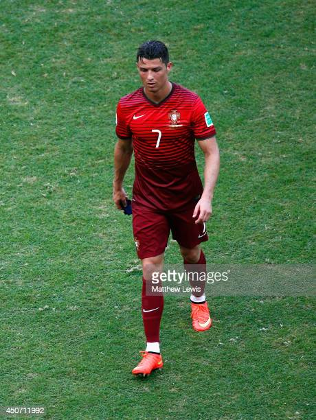 A dejected Cristiano Ronaldo of Portugal walks off the field after being defeated by Germany 40 during the 2014 FIFA World Cup Brazil Group G match...