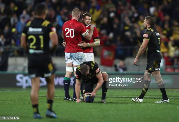A dejected Dan Biggar of the Lions is consoled by teammate George Kruis of the Lions after missing with a last gasp drop goal attempt to win the...