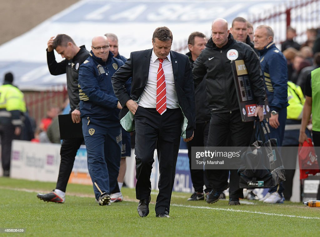 A dejected Danny Wilson, Manager of Barnsley walks off the pitch at the end of the Sky Bet Championship match between Barnsley and Leeds United at Oakwell on April 19, 2014 in Barnsley, England,