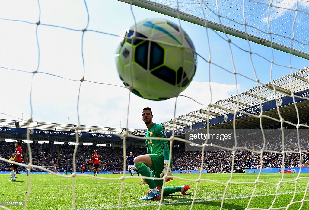 A dejected David De Gea of Manchester United looks at the ball in his net as Leonardo Ulloa of Leicester City scores his team's opening goal during the Barclays Premier League match between Leicester City and Manchester United at The King Power Stadium on September 21, 2014 in Leicester, England.