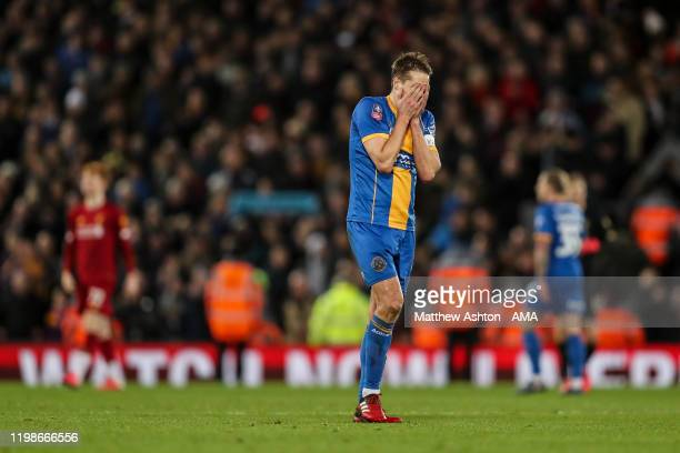 Dejected David Edwards of Shrewsbury Town reacts at full time during the FA Cup Fourth Round Replay match between Liverpool and Shrewsbury at Anfield...