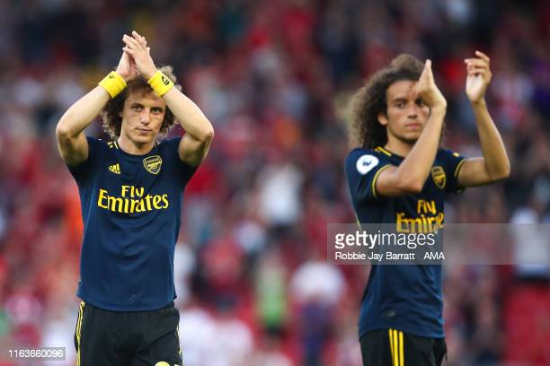 A dejected David Luiz of Arsenal applauds the fans at full time during the Premier League match between Liverpool FC and Arsenal FC at Anfield on...
