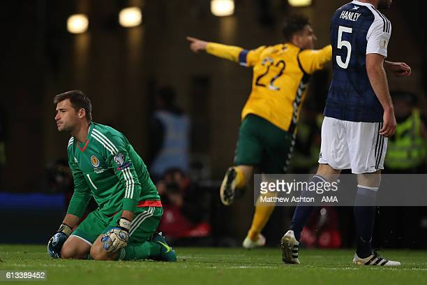 A dejected David Marshall of Scotland as Fiodor Cernych of Lithuania celebrates after scoring a goal to make it 01 during the FIFA 2018 World Cup...