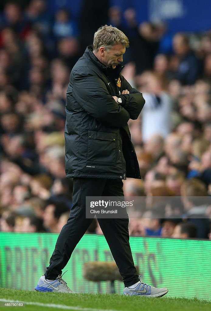 A dejected David Moyes manager of Manchester United looks to the ground during the Barclays Premier League match between Everton and Manchester United at Goodison Park on April 20, 2014 in Liverpool, England.