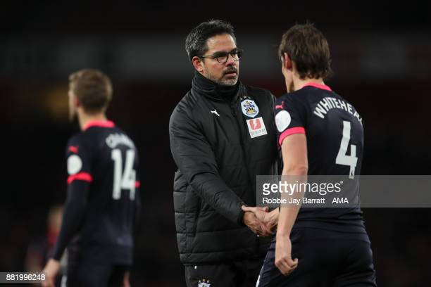 A dejected David Wagner head coach / manager of Huddersfield Town and Dean Whitehead of Huddersfield Town at full time during the Premier League...