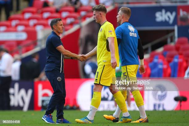 A dejected Dean Henderson of Shrewsbury Town is consoled by Paul Hurst Manager / Head Coach of Shrewsbury Town during the Sky Bet League One Play Off...