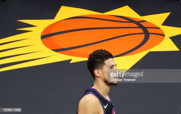 Dejected Devin Booker of the Phoenix Suns leaves the court following the team's loss to the LA Clippers during the second half in Game Five of the...