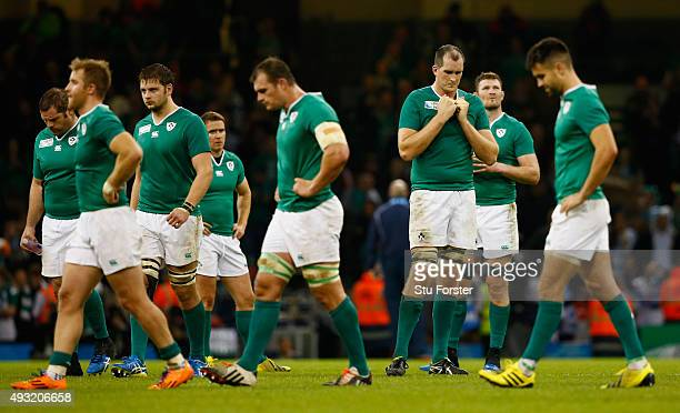 A dejected Devin Toner and Ireland team mates reacts after the 2015 Rugby World Cup Quarter Final match between Ireland and Argentina at Millennium...