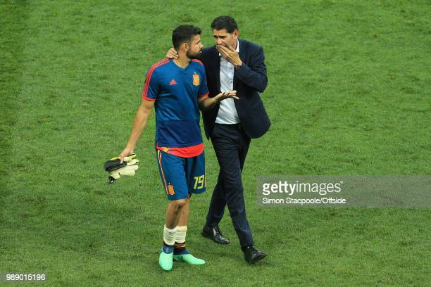 A dejected Diego Costa of Spain speaks with Spain interim coach Fernando Hierro after they are knocked out of the tournament on penalties during the...