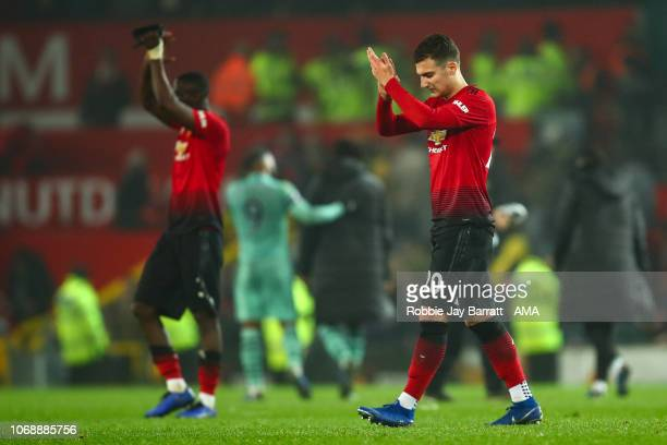 A dejected Digo Dalot of Manchester United applauds the fans at full time during the Premier League match between Manchester United and Arsenal FC at...