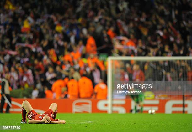 A dejected Dirk Kuyt of Liverpool and goalkeeper Pepe Reina as the referee blows the whistle to end the game sending Atletico de Madrid to the final