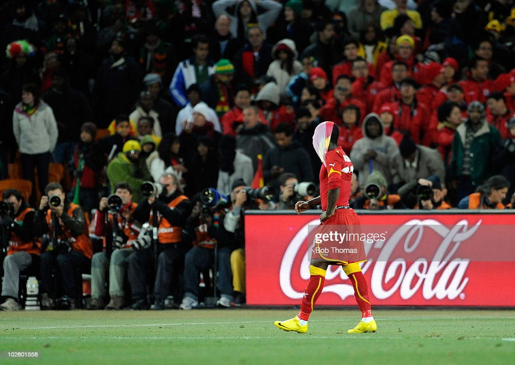A dejected Dominic Adiyiah of Ghana pulls his shirt over his head after having his penalty saved during the 2010 FIFA World Cup South Africa Quarter Final match between Uruguay and Ghana at the Soccer City stadium on July 2, 2010 in Johannesburg, South Africa. The match ended 1-1 after extra-time. Uruguay won 4-2 on penalties.