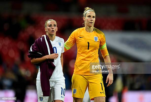 Dejected England players Toni Duggan and Karen Bardsley walk off the pitch following their team's 30 defeat during the Women's International Friendly...