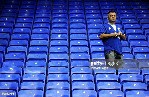 A dejected Everton fan looks on following his team's 61 defeat during the Barclays Premier League match between Everton and Arsenal at Goodison Park...