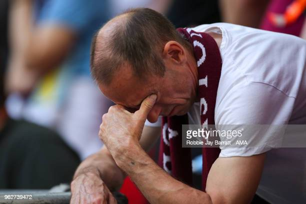 A dejected fan of Aston Villa during the Sky Bet Championship Play Off Final between Aston Villa and Fulham at Wembley Stadium on May 26 2018 in...