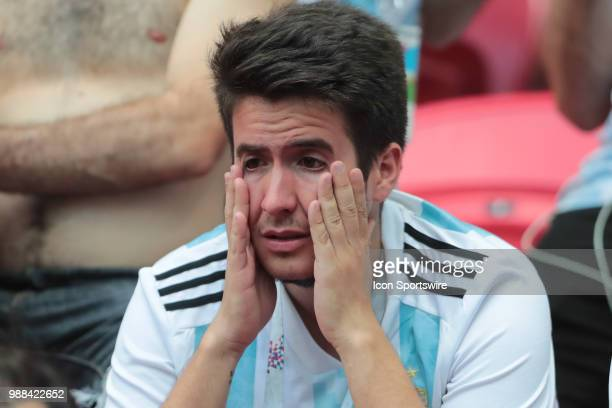 Dejected fans of Argentina after France defeats Argentina 43 in a Round of 16 match of the FIFA World Cup 2018 on June 30 at Kazan Arena in Kazan...