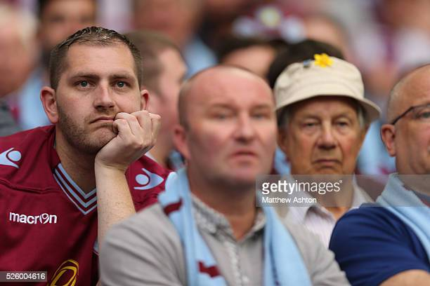 Dejected fans of Aston Villa
