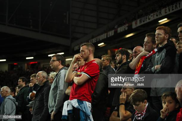 Dejected fans of Manchester United look on during the Premier League match between Manchester United and Tottenham Hotspur at Old Trafford on August...