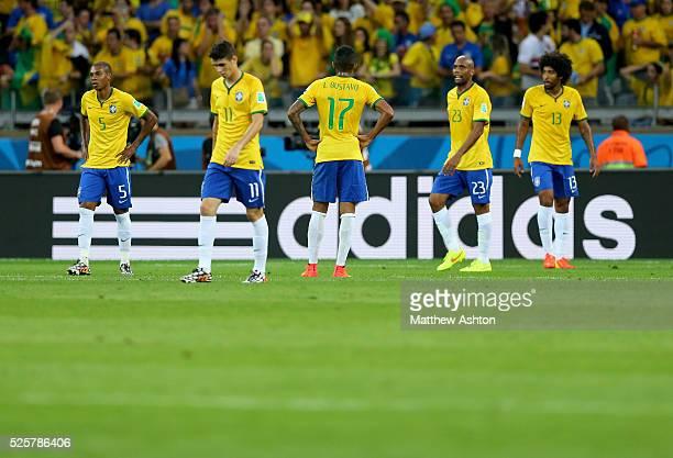 A dejected Fernandinho Oscar Luiz Gustavo Maicon and Dante of Brazil