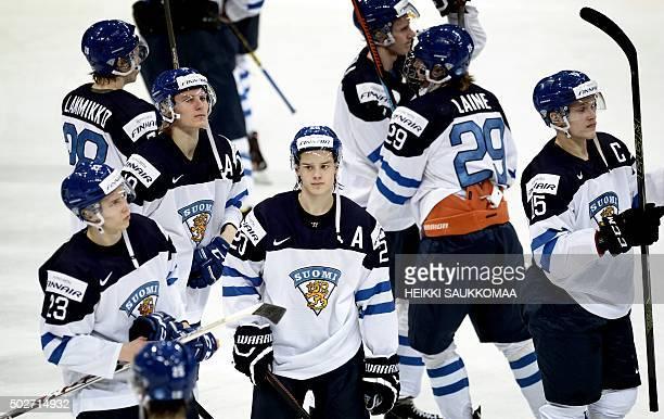 Dejected Finns Sebastian Repo Juho Lammikko Roope Hintz Sebastian Aho Patrik Laine and captain Mikko Rantanen are pictured after the 2016 IIHF World...