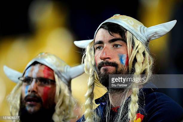 Dejected France fans look on following their team's 14-19 defeat during the IRB 2011 Rugby World Cup Pool A match between France and Tonga at...