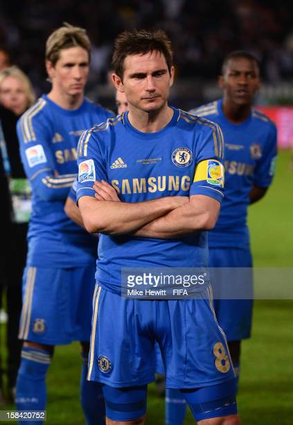 Dejected Frank Lampard of Chelsea with team mates Fernando Torres and Ramires wait for the awards ceremony after the FIFA Club World Cup Final Match...
