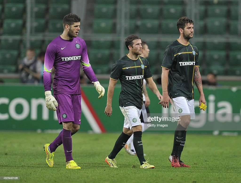 A dejected Fraser Forster, Adam Matthews and Charlie Mulgrew of Celtic leave the pitch after the third qualifying round UEFA Champions League match between Legia and Celtic at Pepsi Arena on July 30, 2014 in Warsaw, Poland.