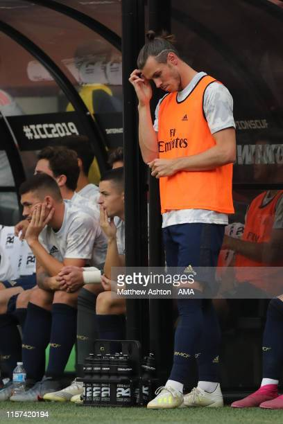 Dejected Gareth Bale of Real Madrid stands in the dugout during the International Champions Cup fixture between Real Madrid and Arsenal at FedExField...