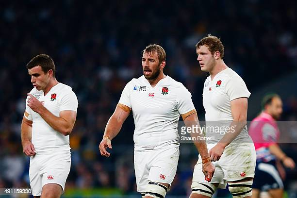 Dejected George Ford Chris Robshaw and Joe Launchbury of England look on during the 2015 Rugby World Cup Pool A match between England and Australia...