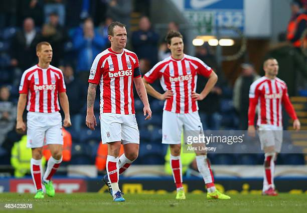 Dejected Glenn Whelan of Stoke City and team mates after conceding a fourth goal during the FA Cup Fifth Round match between Blackburn Rovers and...