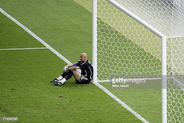 A dejected Goalkeeper Fabien Barthez of France sits on the pitch after failing to save the matchwinning penalty from Fabio Grosso of Italy during the...