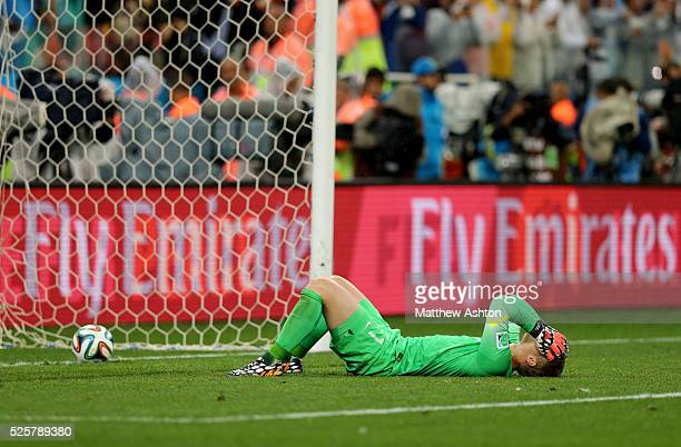 A dejected Goalkeeper Jasper Cillessen of Netherlands' lies on the pitch after the Netherlands lose on penalties and are knocked out of the FIFA...