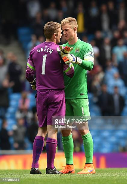Dejected goalkeeper Robert Green of QPR is consoled by Joe Hart of Manchester City following his team's relegation during the Barclays Premier League...