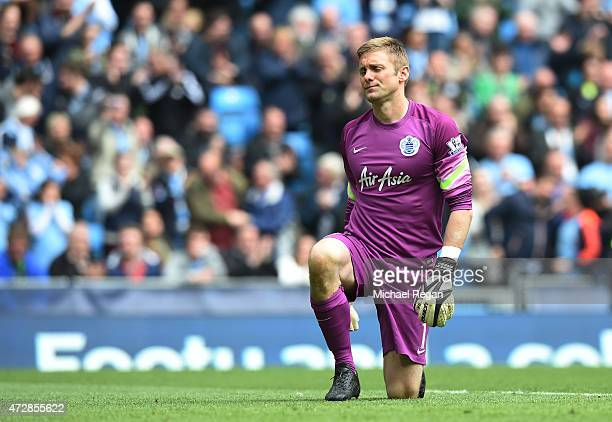 Dejected goalkeeper Robert Green of QPR looks on after conceding a sixth goal during the Barclays Premier League match between Manchester City and...