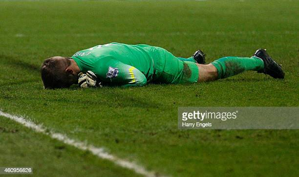Dejected goalkeeper Robert Green of QPR reacts after conceding an injury time goal to level the scores at 11 during the Barclays Premier League match...
