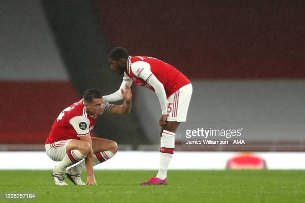 A dejected Granit Xhaka and Ainsley MaitlandNiles of Arsenal at full time during the Premier League match between Arsenal FC and Leicester City at...