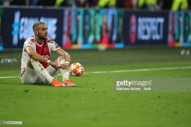 A dejected Hakim Ziyech of Ajax Amsterdam reacts at full time during the UEFA Champions League Semi Final second leg match between Ajax and Tottenham...